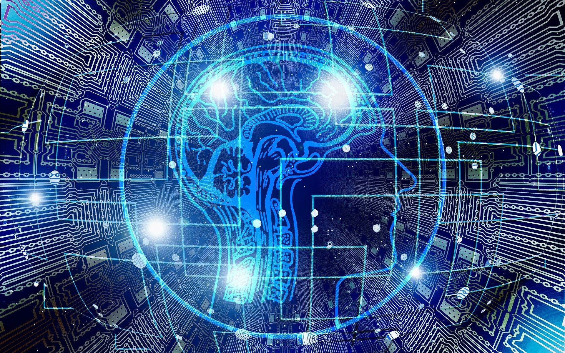 Mesterséges intelligencia témájú grafika: emberi agy, körülötte áramkörre emlékeztető elemekkel.